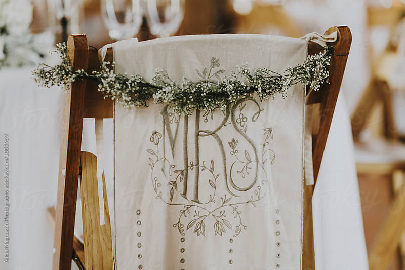 Decorated Wedding Reception Chair in Barn Reception Venue by Alicia Magnuson Photography for Stocksy United