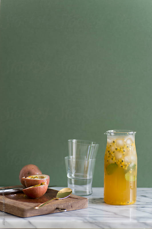 Fresh passion fruit juice by Alita Ong for Stocksy United