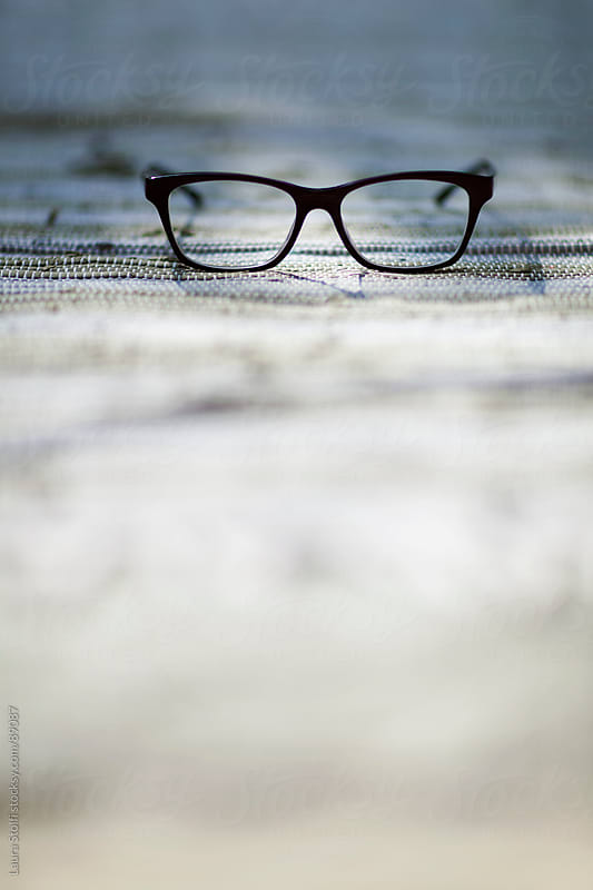 Still life image of glasses with blurred foreground by Laura Stolfi for Stocksy United