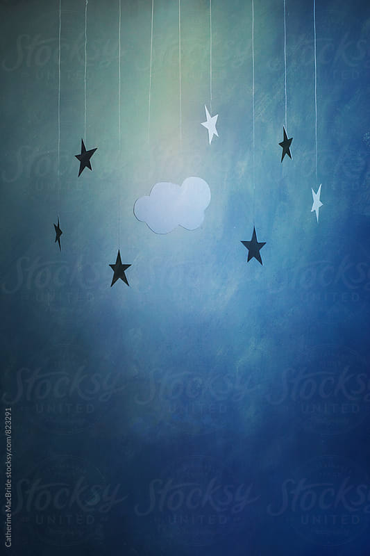 Paper stars and cloud.... by Catherine MacBride for Stocksy United