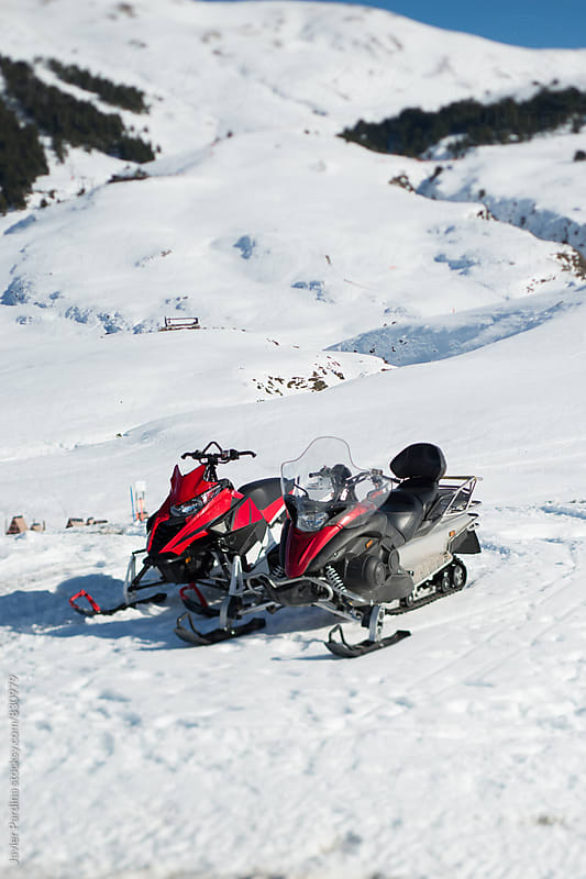 snowmobile in the mountains by Javier Pardina for Stocksy United