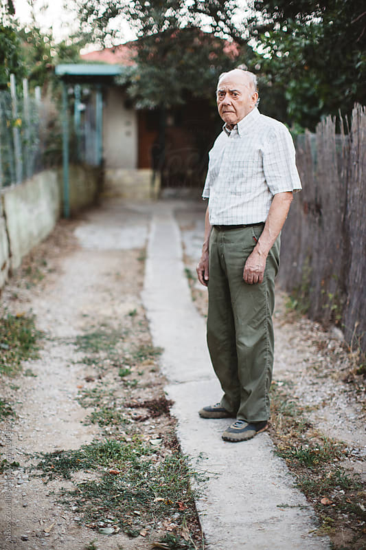 Portrait of a senior man outdoor by Nasos Zovoilis for Stocksy United