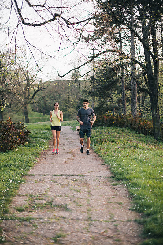 Couple running outdoors by Marija Mandic for Stocksy United