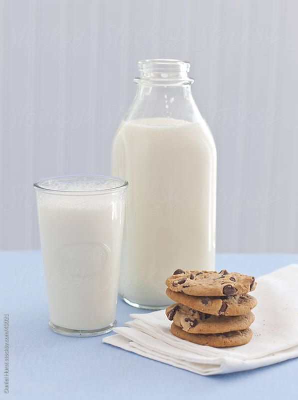 Milk and cookies by Daniel Hurst for Stocksy United