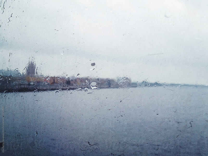 Riga from the window of boat in a rainy day by michela ravasio for Stocksy United