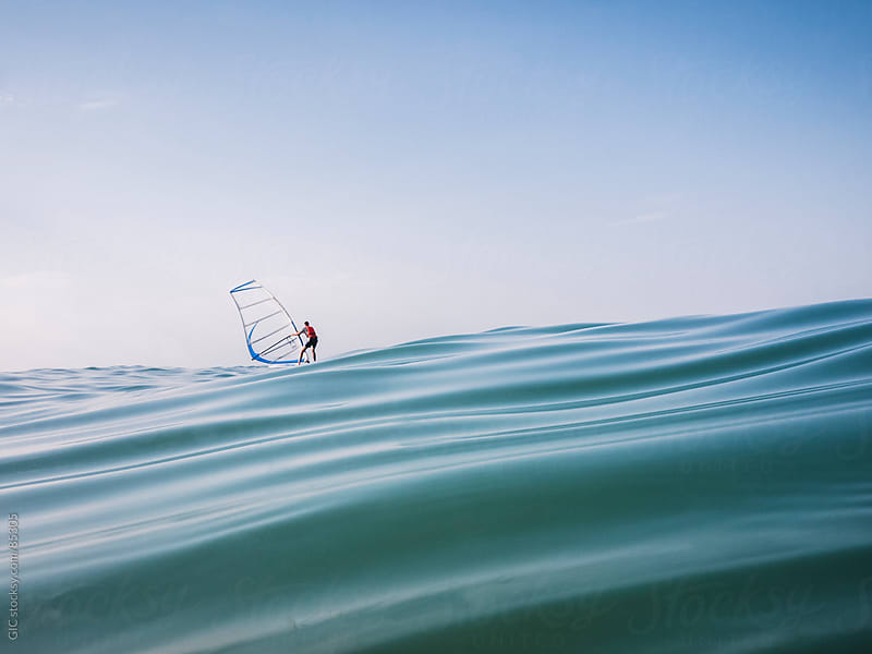 Wind surfer in the sea by GIC for Stocksy United