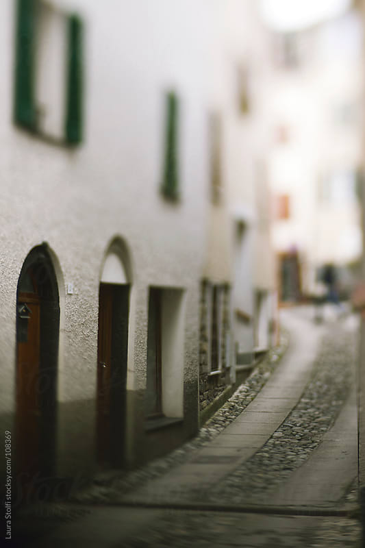 Blurred image of narrow street in italian mountain village by Laura Stolfi for Stocksy United