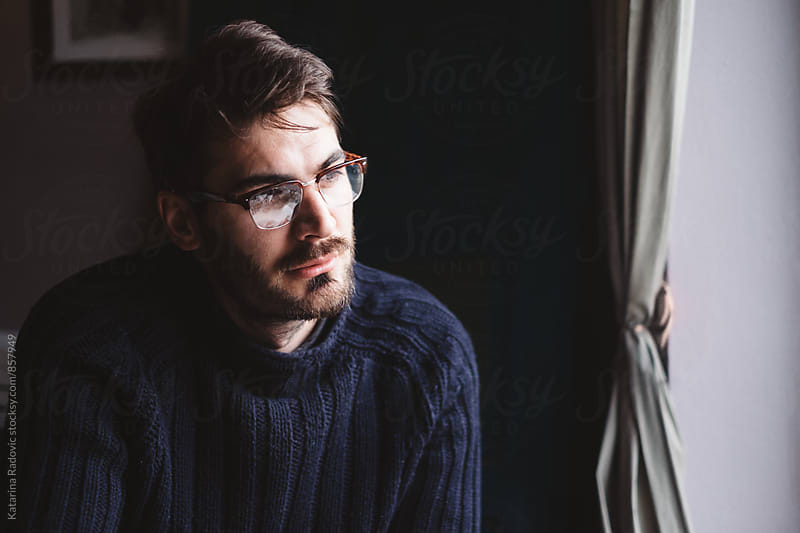 Portrait of a Handsome Man Looking Through The Window by Katarina Radovic for Stocksy United