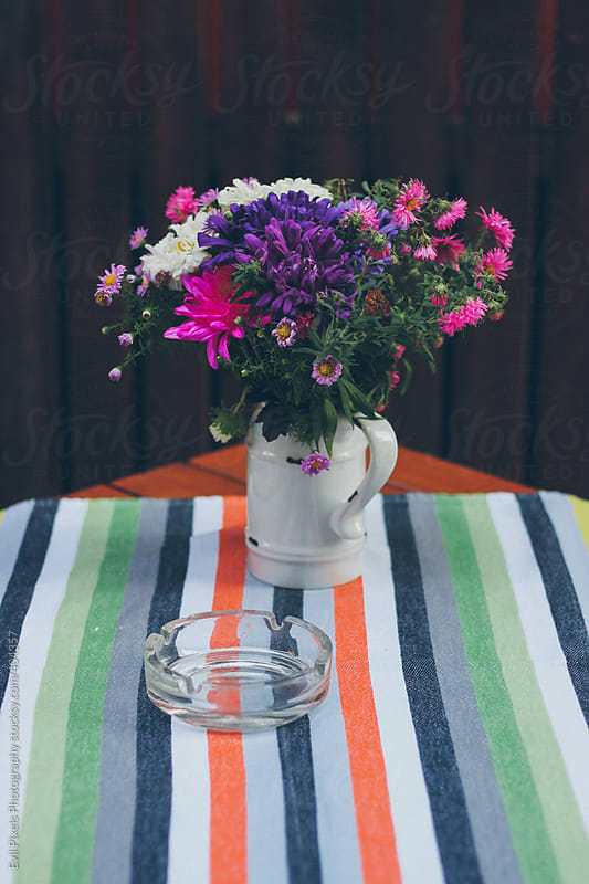 Beautiful flowers on the table  by Evil Pixels Photography for Stocksy United