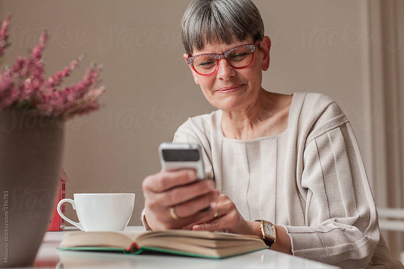 Senior Woman Texting by Mosuno for Stocksy United