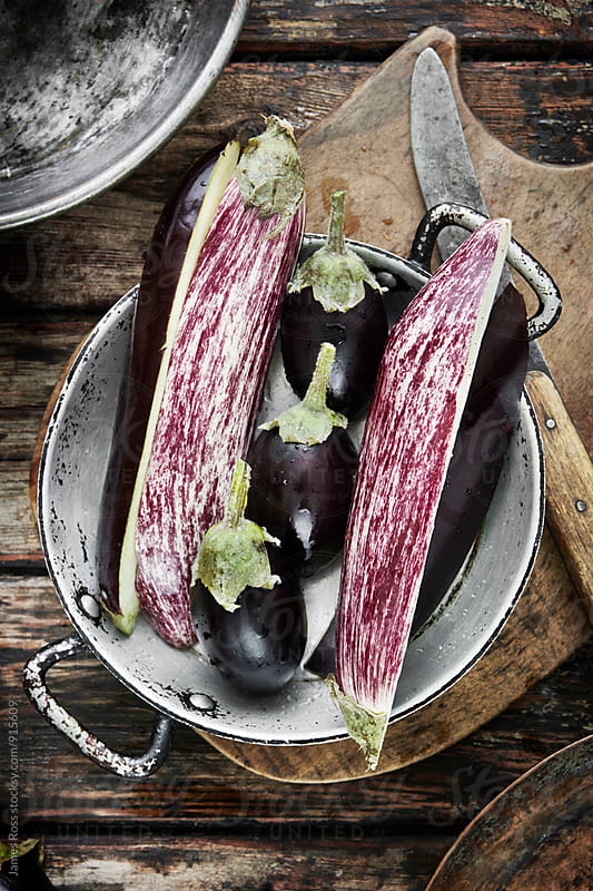Aubergines in a kitchen by James Ross for Stocksy United