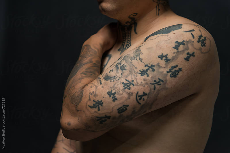 Close up of young man with tattooed upper body by Maa Hoo for Stocksy United