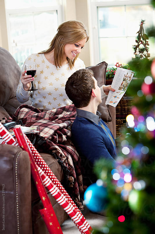 Christmas: Drinking Wine and Catalog Shopping by Sean Locke for Stocksy United
