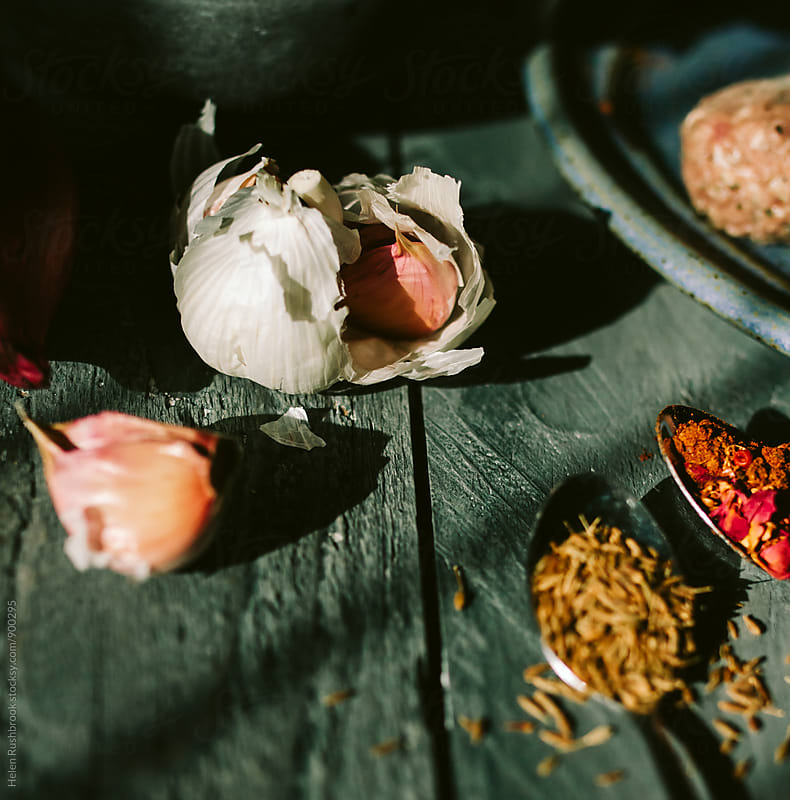 Garlic and spices. Square image. by Helen Rushbrook for Stocksy United