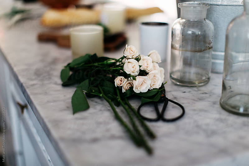 Flowers on marble counter by Matt and Tish for Stocksy United