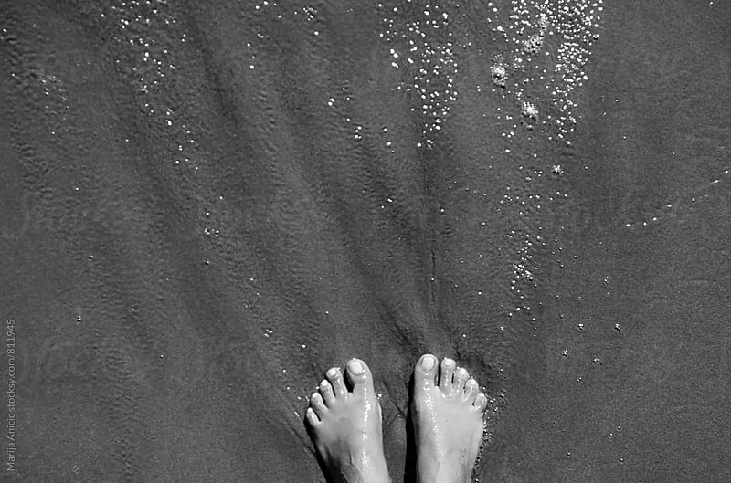 Feet in the sand by Marija Anicic for Stocksy United
