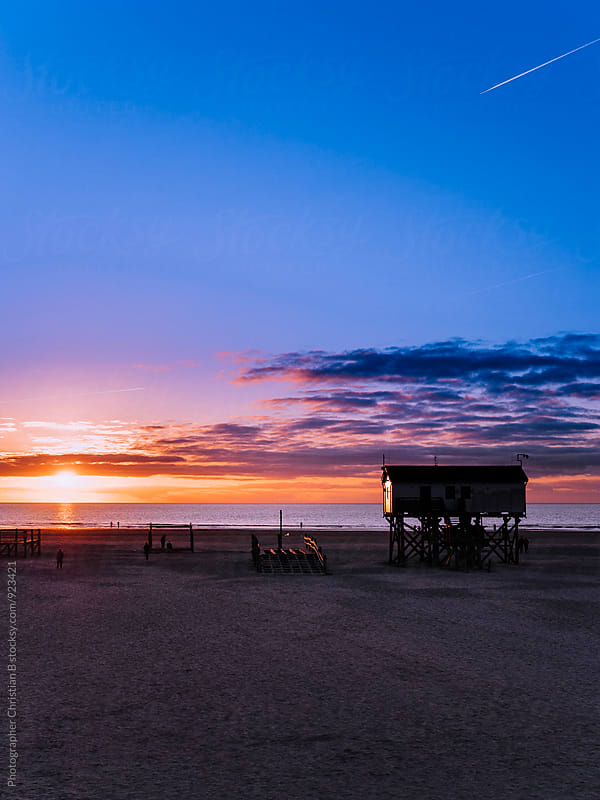 Sunset at the beach house by Photographer Christian B for Stocksy United