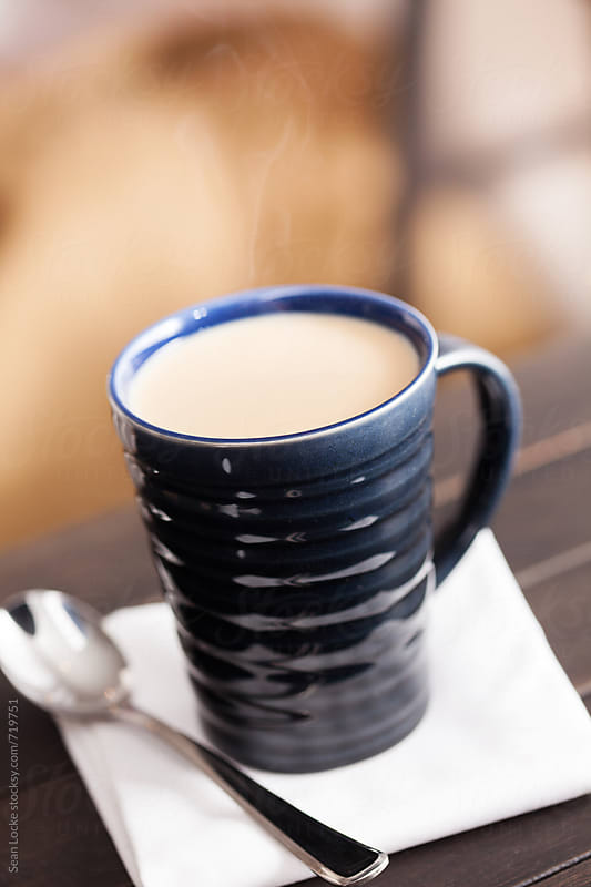 Hot Chai Tea Drink In Dark Blue Mug With Spoon by Sean Locke for Stocksy United