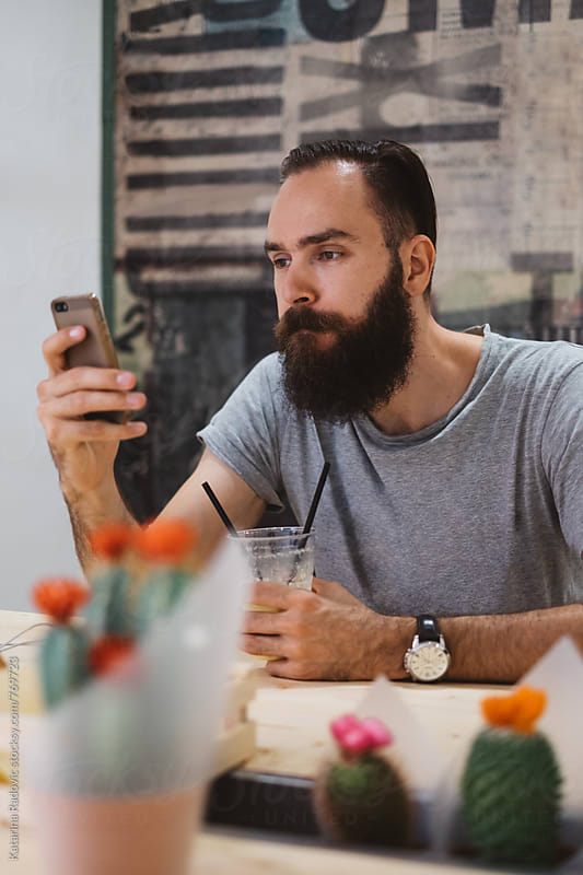 Handsome Bearded Man Using his Phone by Katarina Radovic for Stocksy United