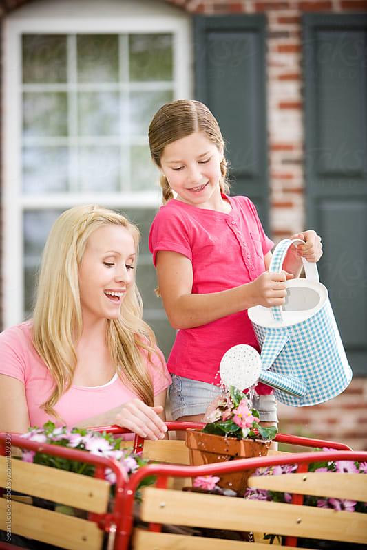 Planting: Girl and Mom Having Fun Gardening by Sean Locke for Stocksy United