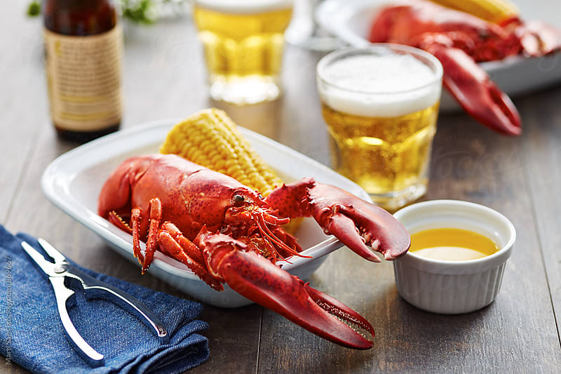 Boiled lobster with corn and butter by Martí Sans for Stocksy United