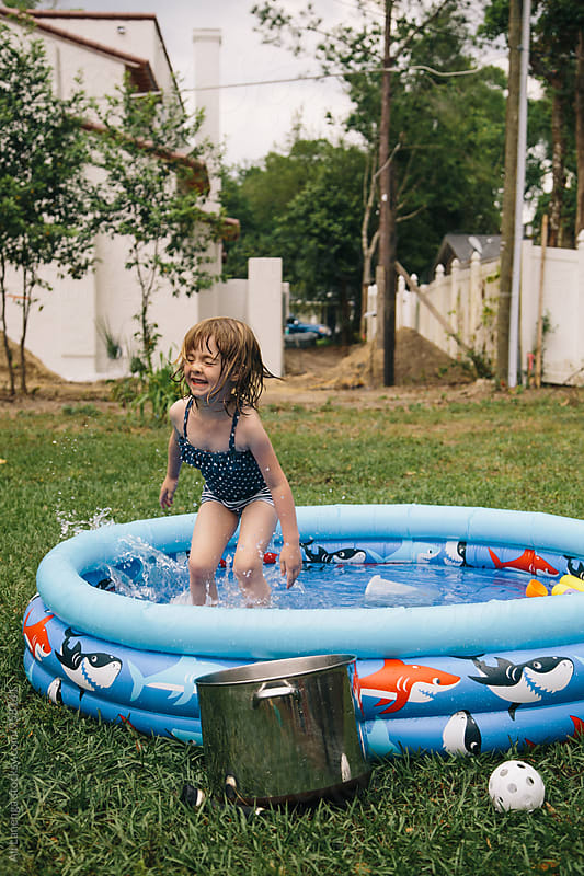 Backyard Splash by Ali Lanenga for Stocksy United