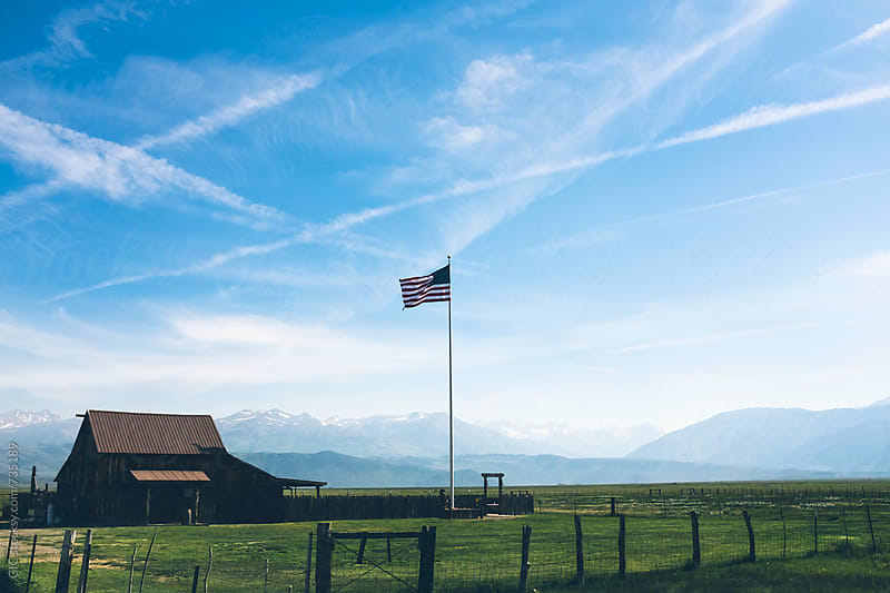 American flag and ranch in Sierra Nevada by Simone Becchetti for Stocksy United