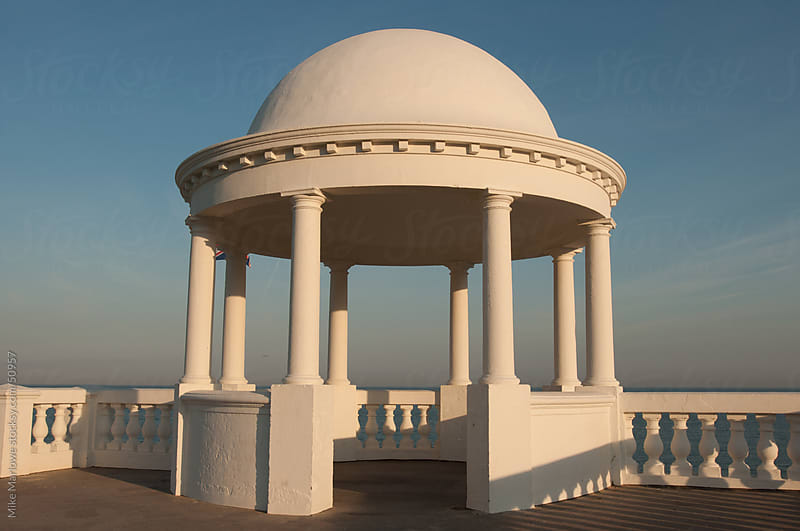 White stone structure for providing shelter near the sea with dome roof. by Mike Marlowe for Stocksy United