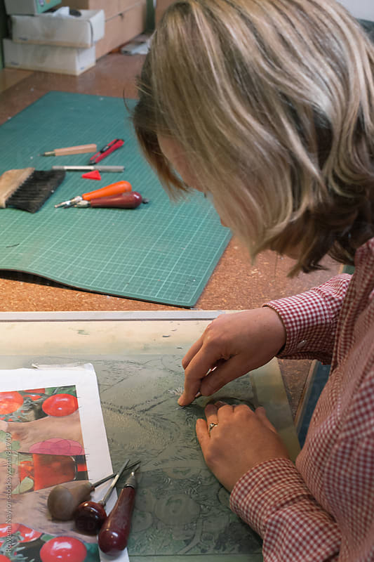 Print Artist at work in art studio by Rowena Naylor for Stocksy United