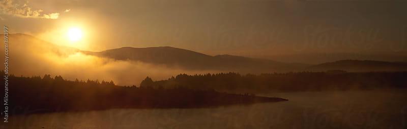 Sunrise on foggy lake by Marko Milovanović for Stocksy United