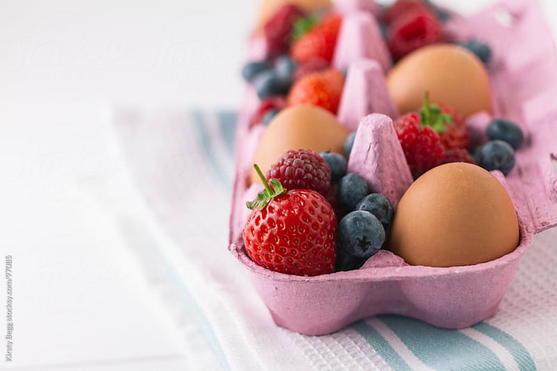 Eggs and Summer Berries horizontal by Kirsty Begg for Stocksy United