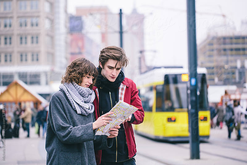 Young couple exploring the city by michela ravasio for Stocksy United