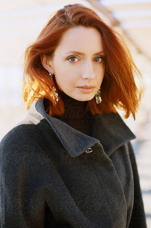Portrait of redhead woman by Lyuba Burakova for Stocksy United