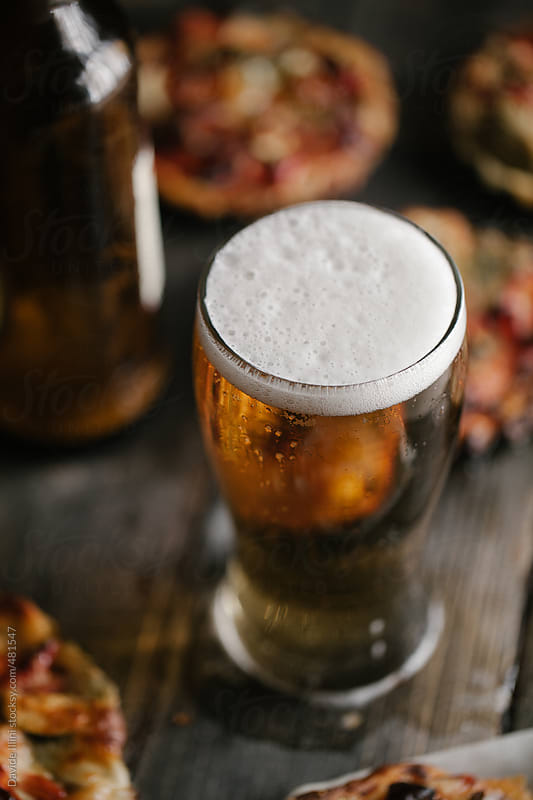 Glass of fresh lager beer by Davide Illini for Stocksy United