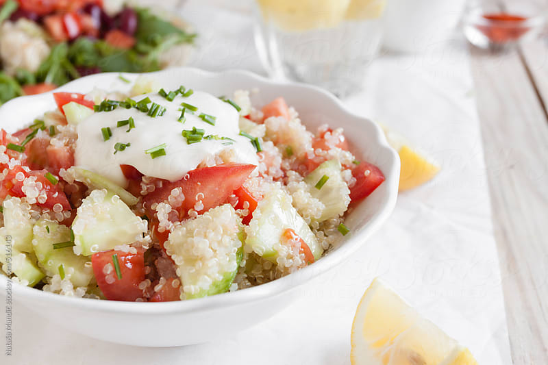 Quinoa salad with cucumber and tomato by Nataša Mandić for Stocksy United