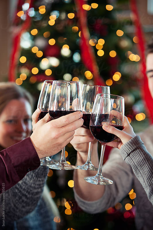 Christmas: Party Guests Celebrate with a Toast by Sean Locke for Stocksy United