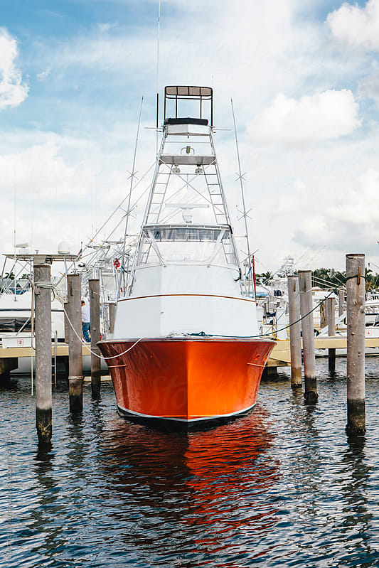 Orange fishing boat in Marina by Stephen Morris for Stocksy United