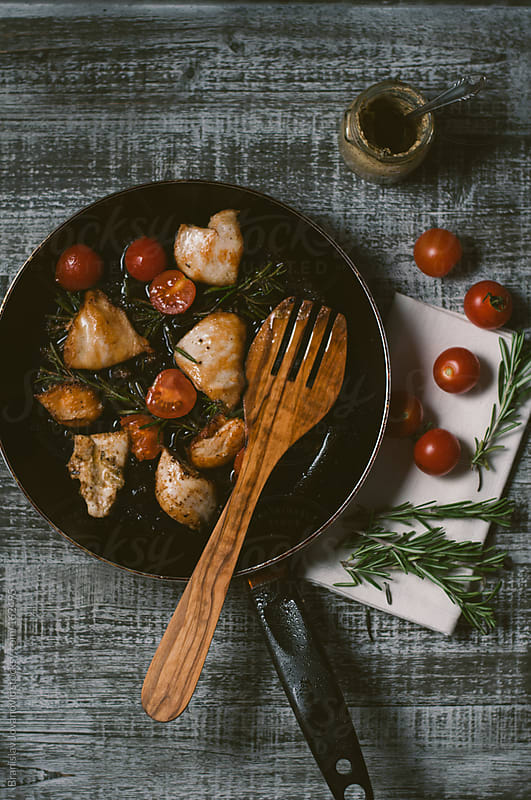 Preparing grilled chicken with vegetables by Brkati Krokodil for Stocksy United