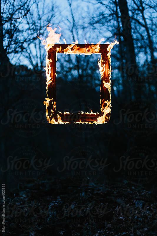 frame of flames in the dark by Brian Powell for Stocksy United