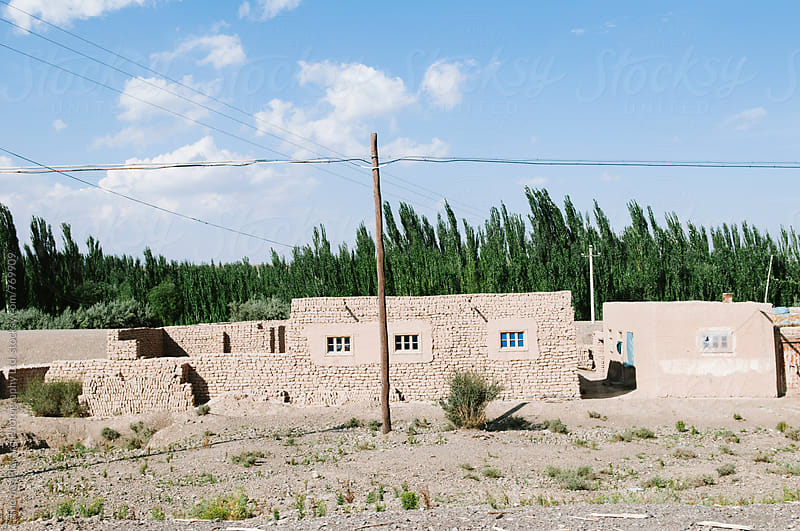 Mud brick home, west of Kashgar, China. by Thomas Pickard for Stocksy United