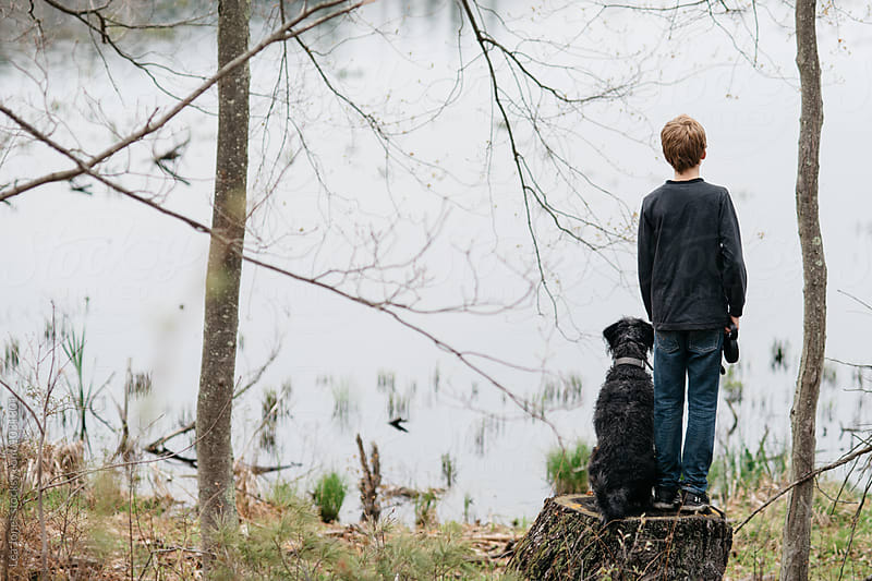 Boy on walk with his dog by Léa Jones for Stocksy United