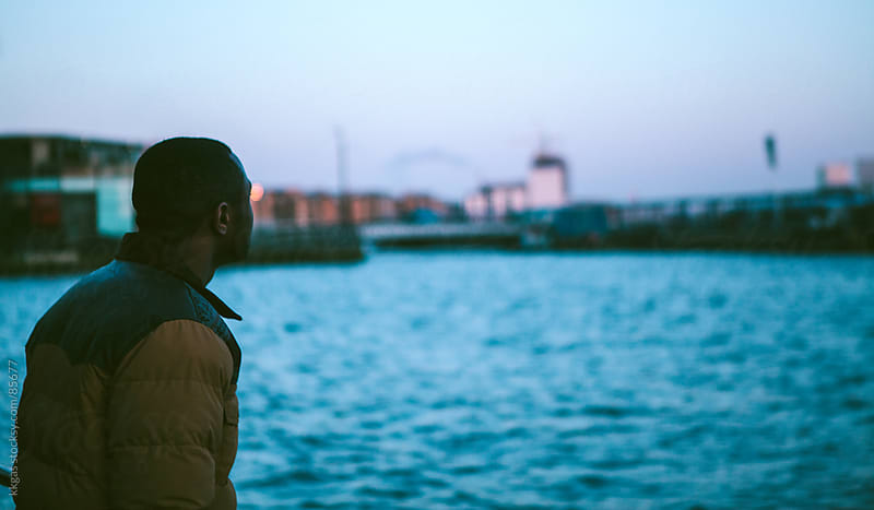Young man looking across The Thames London by kkgas for Stocksy United