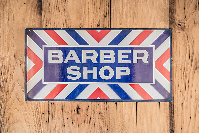 Antique Metal Barber Shop Sign by suzanne clements for Stocksy United