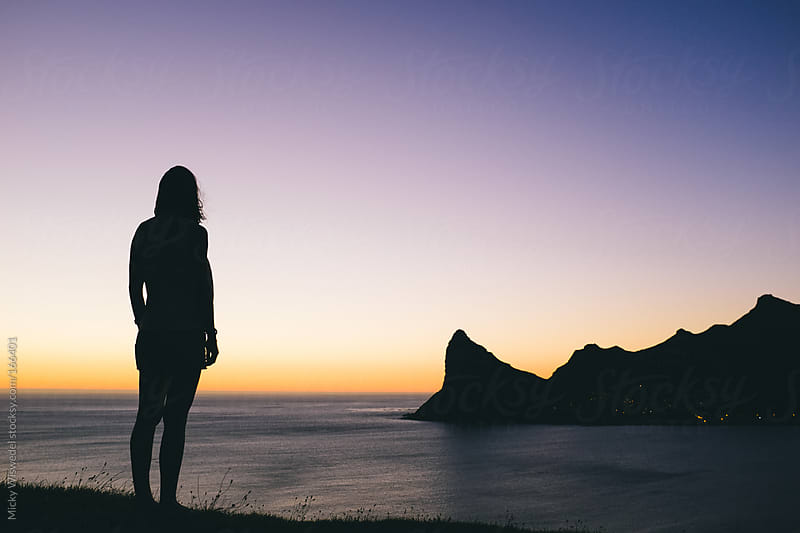 Woman taking in a sunset view by Micky Wiswedel for Stocksy United