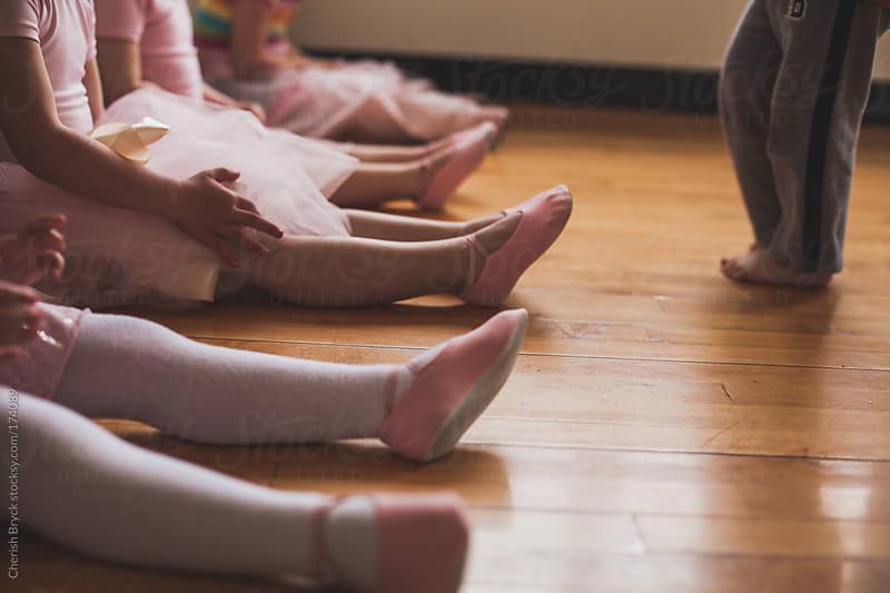 Boy approaches little ballerinas. by Cherish Bryck for Stocksy United