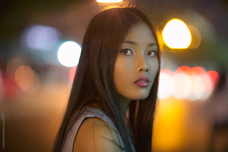 Portrait of an Asian Woman on the Street by Lumina for Stocksy United