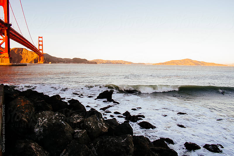 Surfin by the Golden Gate by Oscar Lopez for Stocksy United