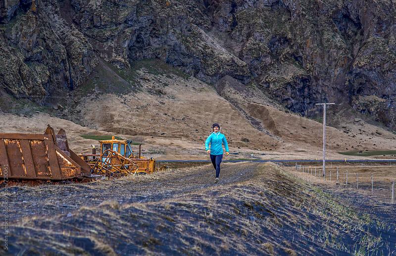 Sporty woman running outdoors by Soren Egeberg for Stocksy United