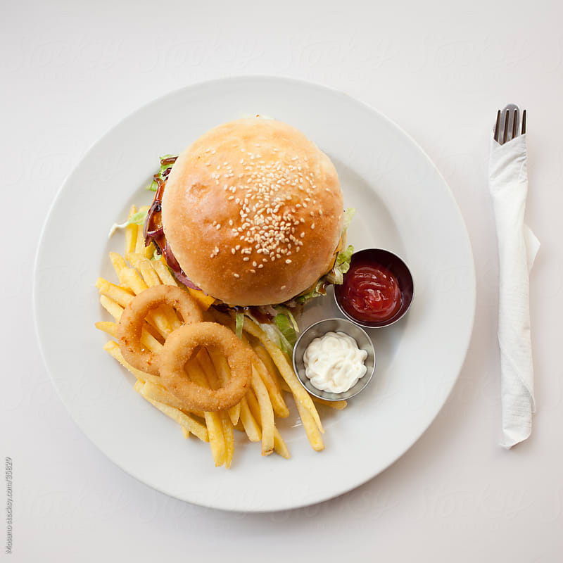 Hamburger served in a restaurant. by Mosuno for Stocksy United