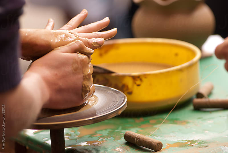Potter shaping clay by Pixel Stories for Stocksy United